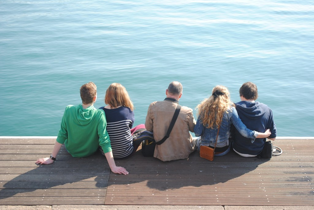 group-sitting-by-water