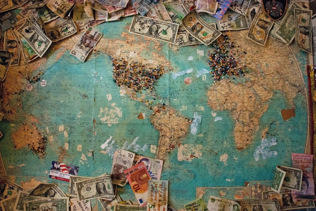 world map with multiple currencies spread along the outside edge
