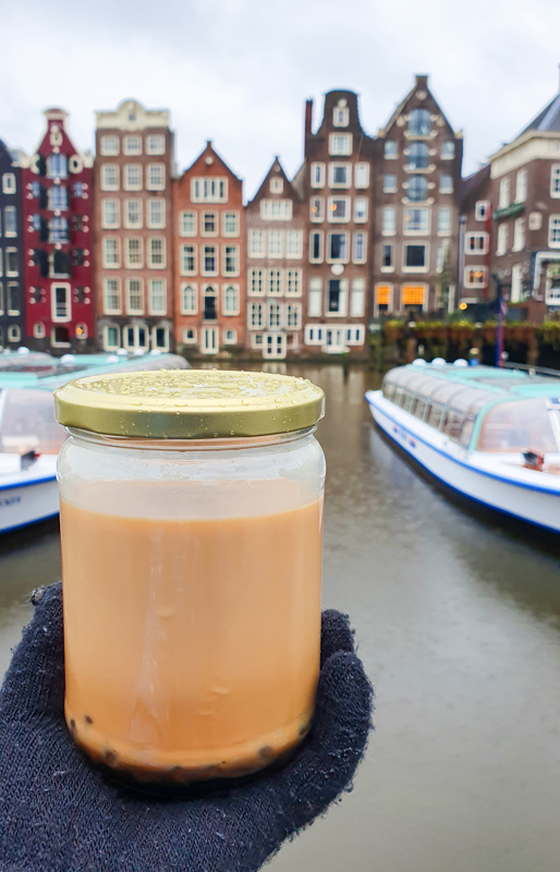 Bubble tea from Jackie Cha in a jar in front of Amsterdam canal houses