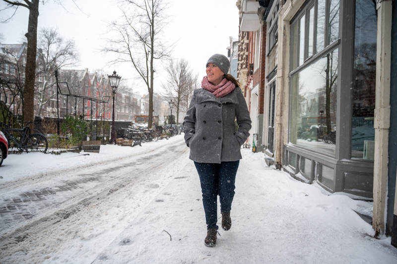 Jessica walking in the snow in Amsterdam toward the camera